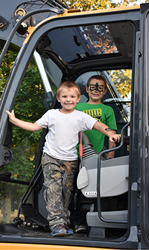 L-R: Brayden (white shirt) and Bryce in the cab of a bucket loader at National Night Out in Acushnet on 8/2/16.