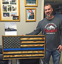 Hand made wooden flag donated to Fairhaven Police