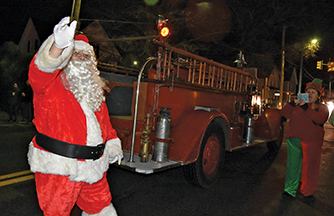 Santa joins the crowd at Benoit Square lighting and sing-along