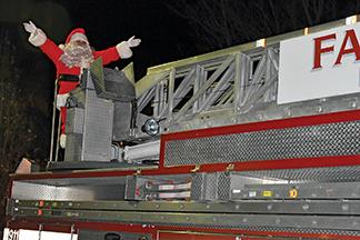 Santa visits town hall sing-along