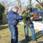 Volunteers place wreaths to honor veterans at Fairhaven cemeteries