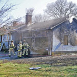 Fire on Brook Drive injures one, destroys garage, cars